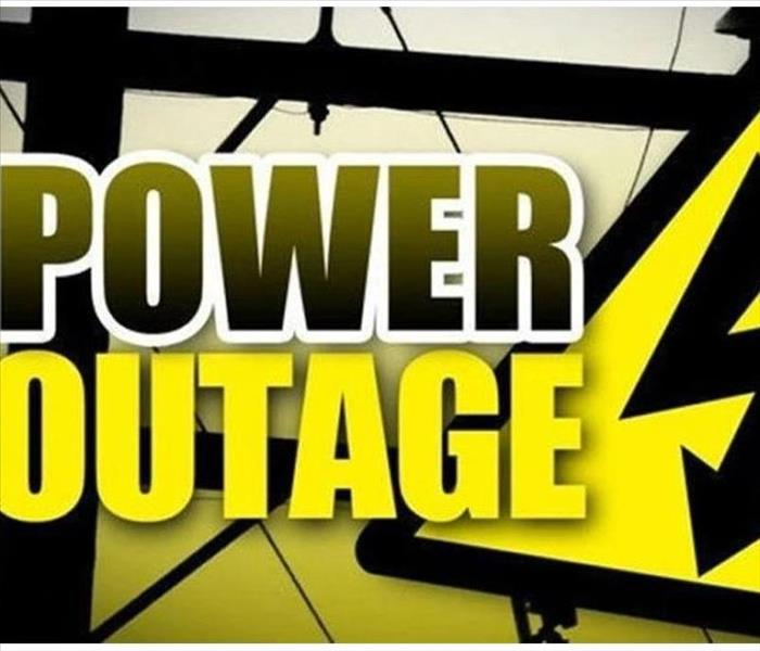 Power outage sign and electrical wires