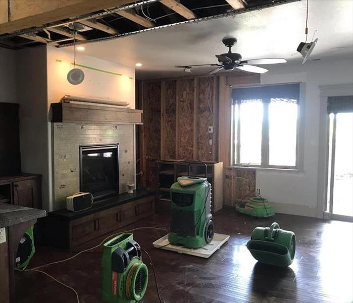 living room with four pieces of green drying equipment