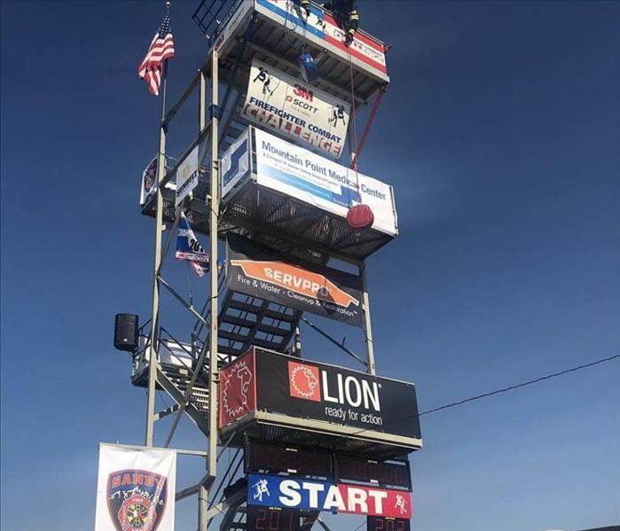 Ladder for the challenge with sponsor flags on it