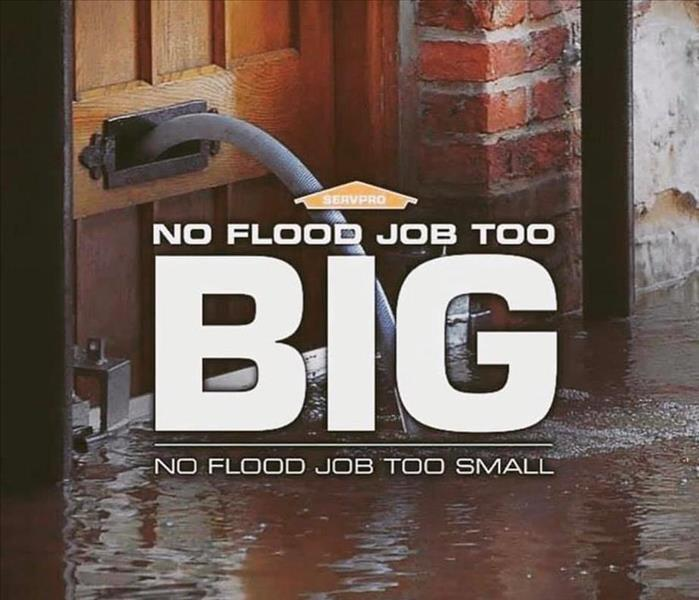 flooded water to a door with a saying that says  no flood job to big no job to small.