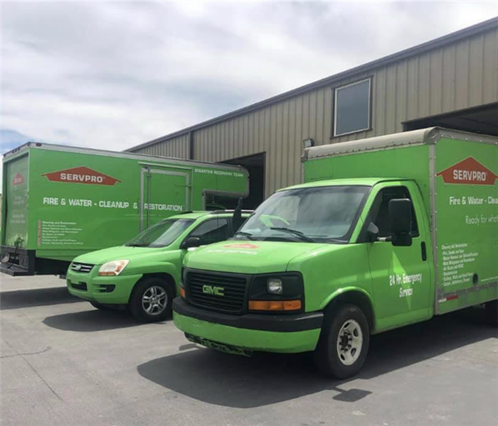 Our green SERVPRO vehicle parked outside our building.