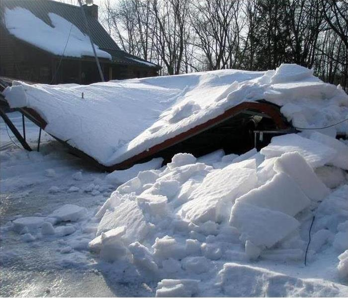 Storm Damage Snow Covered Roof, Majestic or Dangerous?